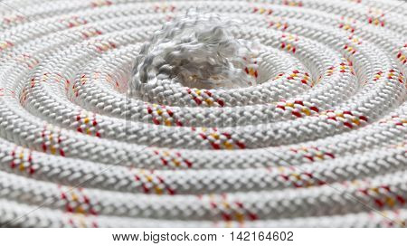 Macro of thick rope curved in spiral hank