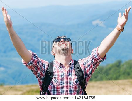 Backpacker Feeling Happy And Victorious On The Mountain
