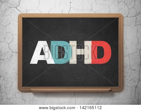 Medicine concept: Painted multicolor text ADHD on School board background, 3D Rendering