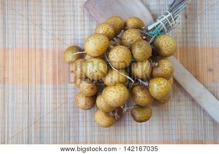 longan (dimocarpus longan) with a bunch of ripe longan