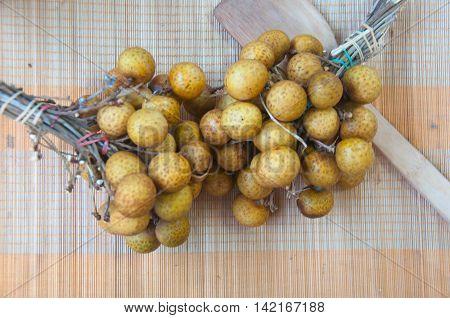 Close up fresh Longan fruit Thailand on mat