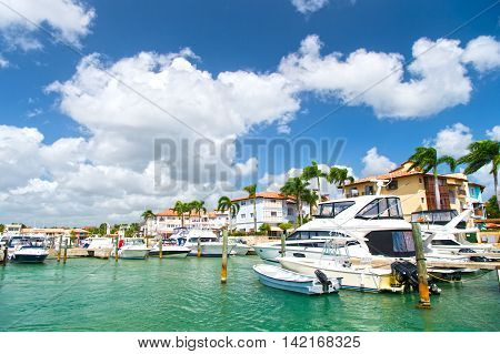 La Romana Dominican Republic - February 16 2016: luxury yachts docked in the port in bay at sunny day with clouds on blue sky in La Romana Dominican Republic