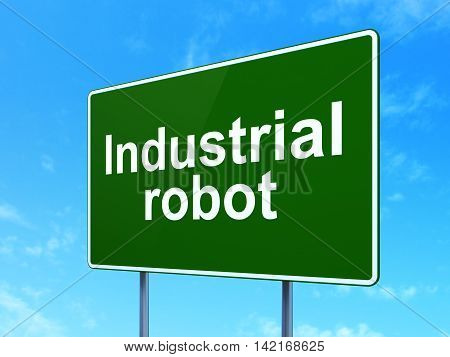 Industry concept: Industrial Robot on green road highway sign, clear blue sky background, 3D rendering