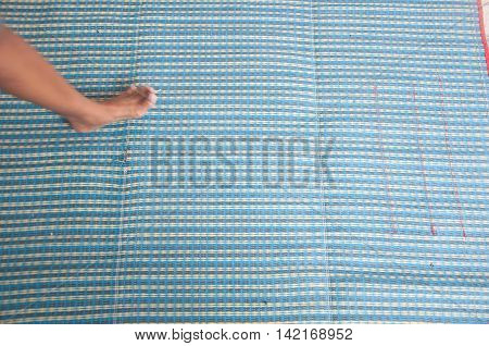 foot on blue mat Thailand, mat background