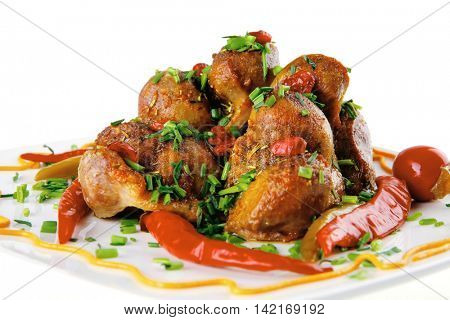 served beef meat balls with red hot peppers