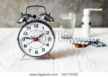 metal alarm clock time to take medicine