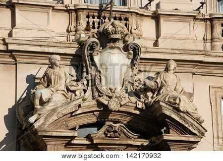 King of Italy (Savoy Familiy) emblem between vitues Religion and Justice in Quirinale Square in Rome made by artist Francesco Maini in the 19th century