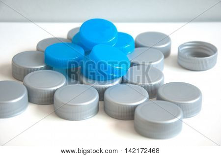 pile of cap bottle on white table