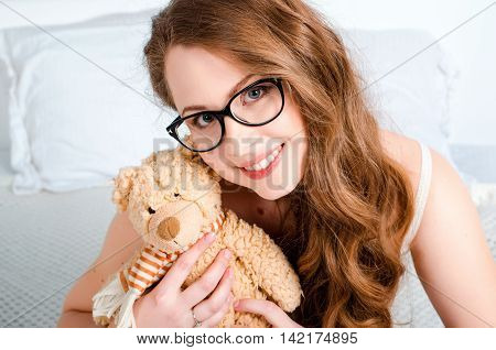 Portrait Of A Happy, Cheerful, Young Blonde Girl With Glasses, S