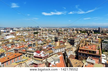 an aerial view of Valencia, Spain, as seen from the Micalet, the belfry of the Cathedral, highlighting the Serranos Gate to the left, in the Carmen district