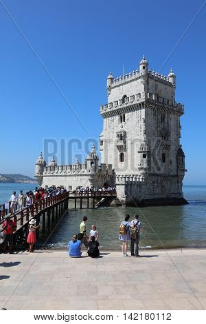 Lisbon, Portugal - July 28, 2016: Tourist queue at Belem Tower (Tower of Saint Vincent), one of the major tourist attractions in Lisbon. Portugal