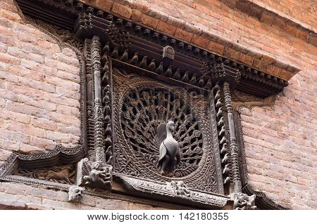 Bhaktapur, Nepal - December 4, 2014: A beautiful carved window called the Peacock window