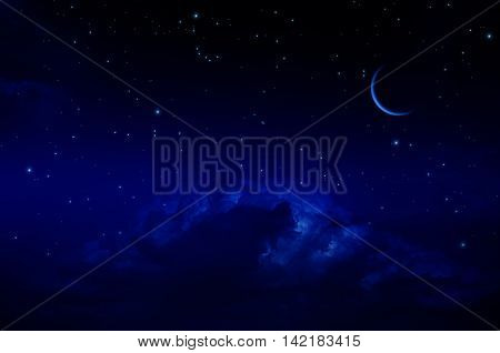 Night sky with stars and clouds. Thin arc moon. Dark blue tint