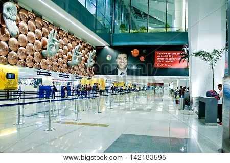 New Delhi India - Jule 20 2011: Passengers arrive at check-in counters at Indira Gandhi International Airport. Hands show the rack number of check-in. Mostly Indian people who illiterate.