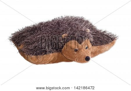 Travel pillow hedgehog shaped which can be rolled up and buttoned on a light background