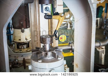 This picture show dial gauge analog on the job installation pum and motor for alignment pump.