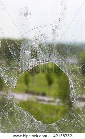 Broken glass window broken by a bullet