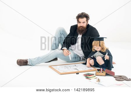 Small Boy Drawing With Teacher