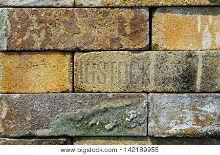 Vintage Brownish Bricks Stacked Atop Each Other