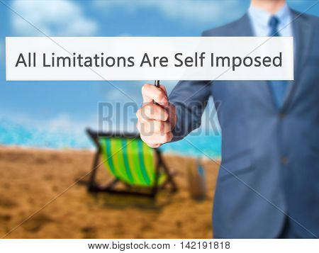 All Limitations Are Self Imposed - Businessman Hand Holding Sign