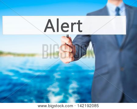 Alert - Businessman Hand Holding Sign