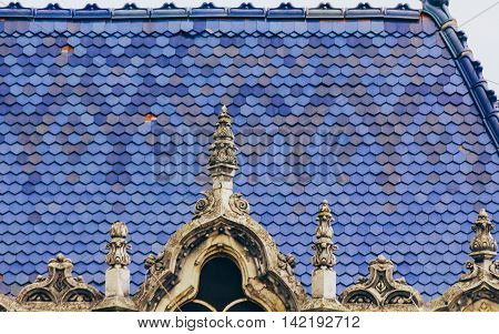 Art nouveau style roof with blue tiles