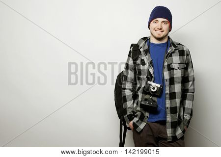 technology, people and life style concept: young  photographer over white background