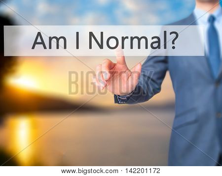 Am I Normal ? -  Businessman Press On Digital Screen.