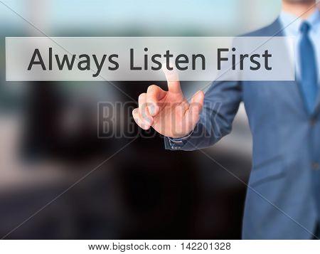 Always Listen First -  Businessman Press On Digital Screen.