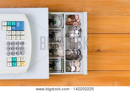 Above View On Cash Register Full Of Coins