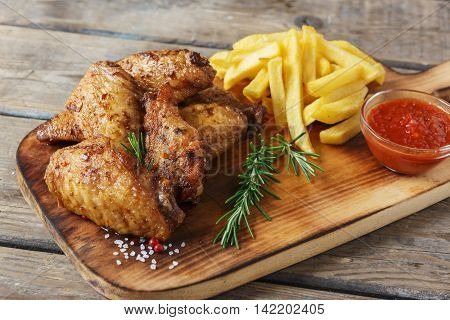 fried chicken wings french fries and sauce