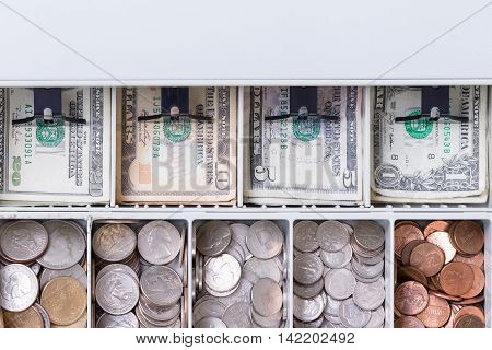 Close Up On American Currency In Cash Drawer