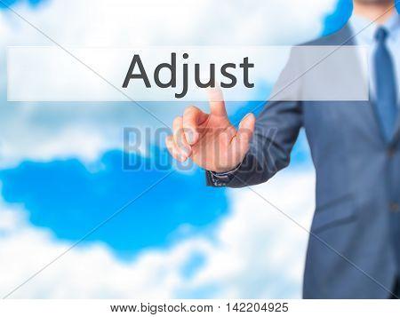 Adjust -  Businessman Press On Digital Screen.