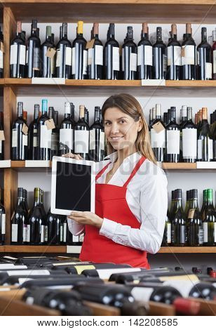 Smiling Saleswoman Showing Blank Digital Tablet