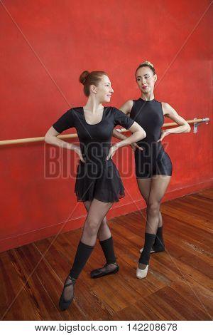 Ballerinas Performing In Rehearsal Room