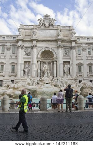 ROME ITALY - AUGUST 7 2016: Tourists visiting the Trevi Fountain an iconic symbol of the Italian Baroque period