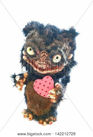 Teddy Monster on a white background with two hearts in paws toy for interior courtesy beast