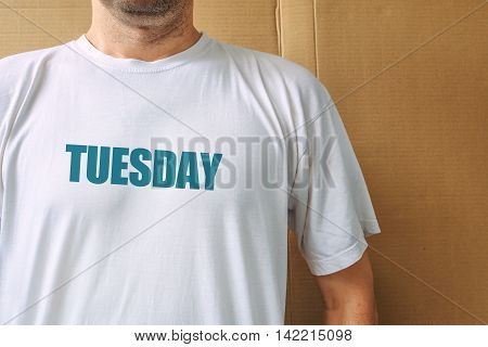 Days of the week - tuesday man wearing white t-shirt with name of the second weekday printed