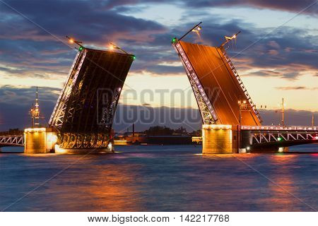 Divorced Palace bridge, cloud june night. Saint Petersburg, Russia
