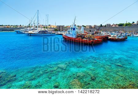 Boats in Mandraki Harbor. Rhodes Town, Rhodes, Greece