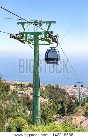 Cable car with cabins in landscape of Madeira between Funchal and Monte