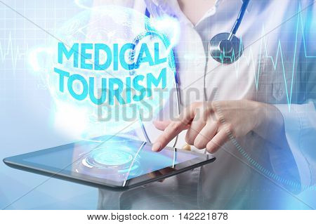 Modern Medicine. Medicine Doctor Working On The Tablet Of The Future, Presses A Button On The Screen