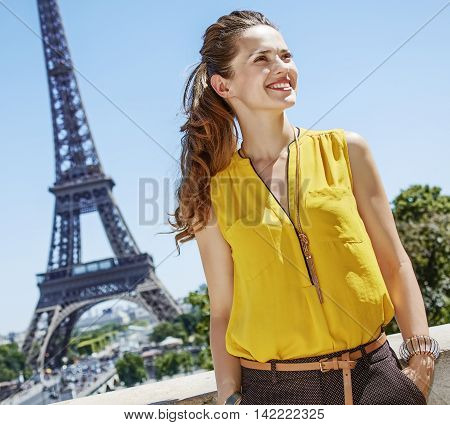 Smiling Young Woman Looking Aside While In Paris, France