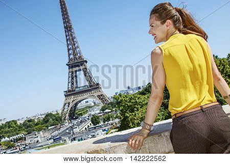 Smiling Young Woman Looking Aside In Paris, France