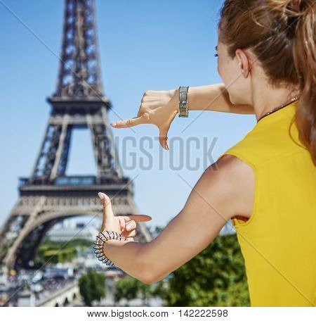 Young Woman Framing With Hands In Paris, France
