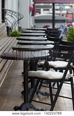 Tables and chairs of street cafes in the city