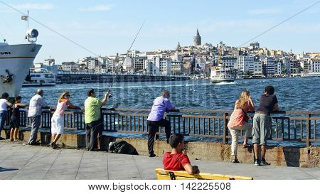 Istanbul Turkey - January 01 2011: Istanbul Sea of Marmara the Golden Horn Galata Tower and Cityscape. Eminonu Istanbul scenery on the beach watching the tourists to see.