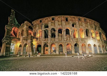 Colosseum In The City Center In Rome Italy At Dusk