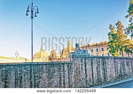 Roman Walls And Piazza Del Popolo In Rome In Italy