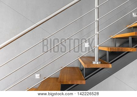 Simple Staircase With Chromed Railing Idea